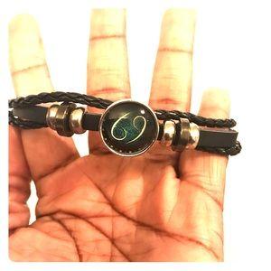 3 strand black leather bracelet w 69 pendant